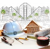 picture of engineering construction  - architect working table and two point perspective modern building plan use for construction engineering and real estate land development industry - JPG