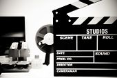 Clapper Board With Vintage Movie Editing Desktop In Black And White