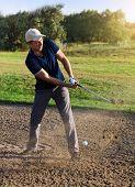 Golfer Plays A Sand Trap Shot