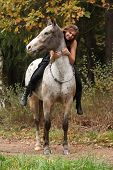 image of appaloosa  - Beautiful girl riding a horse without bridle or saddle in autumn - JPG