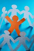 A circle of paper cutted people with clipping path on blue