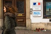 KRAKOW, POLAND - JAN 11, 2015: Action near the facade of the Consulate General of France in Krakow solidarity for the victims of the Charlie Hebdo attacks in Paris.