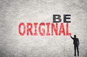 Asian businessman write text on wall, Be Original