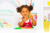 picture of kindergarten  - Beautiful Hispanic girl play with modeling clay in the class at kindergarten - JPG