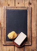 foto of bath sponge  - Bath Spa Setting with soap and natural wild sponge on chalk board - JPG