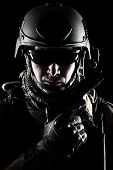 stock photo of pistols  - United States Army ranger with pistol on dark background - JPG