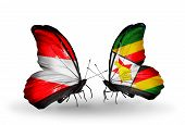 Two Butterflies With Flags On Wings As Symbol Of Relations Austria And Zimbabwe