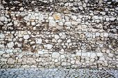 stock photo of paving stone  - Wall of stones and a stone paving - JPG