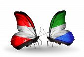 Two Butterflies With Flags On Wings As Symbol Of Relations Austria And Sierra Leone