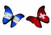 Concept - Two Butterflies With Honduras And Switzerland Flags Flying, Like Two Football Teams Playin