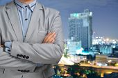 Business Man Standing In Front Of Blur Background Of Building Or Cityscape