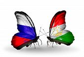 Two Butterflies With Flags On Wings As Symbol Of Relations Russia And Tajikistan