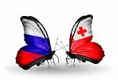 Two Butterflies With Flags On Wings As Symbol Of Relations Russia And Tonga