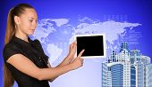 Business woman holds tablet PC, pointing at blank screen