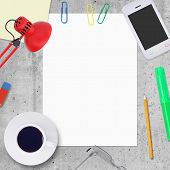 Blank paper sheet with office work elements around