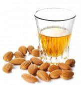 Dessert liqueur Amaretto with almond nuts, isolated on white