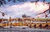 Beautiful Prague in winter, Charles bridge over Vltava river, Czech republic, historical  medieval buildings, wintertime European cityscape