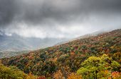 Fog Rolls In Over Mountain Slop In Fall