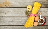 Pasta, eggs and spices on wooden table background with copy space