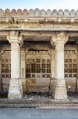 stock photo of sufi  - Carved stone grilles on the walls of the Tomb of Sufi Saint Shaikh Ahmed Khattu at Sarkhej Roza in Ahmedabad India - JPG