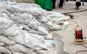 stock photo of sandbag  - White sandbags for flood defense closeup photo
