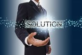 Businessman hand showing solution button.