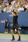 Grand Slam champion Roger Federer celebrates victory after quarterfinal match at US Open 2014