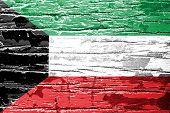 Kuwait flag painted on old wood texture