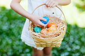 stock photo of easter basket eggs  - Close up of colorful Easter eggs in a basket - JPG