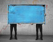 Two Businessman Hold Old Blue Blank Wooden Billboard