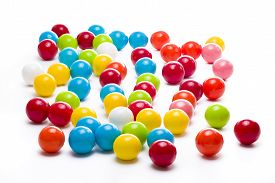 picture of gumballs  - Multicolored gumballs sitting in a white background - JPG