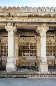 image of sufi  - Carved stone grilles on the walls of the Tomb of Sufi Saint Shaikh Ahmed Khattu at Sarkhej Roza in Ahmedabad India - JPG