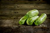 pic of zucchini  - Ripe zucchini and marrow vegetables isolated on wooden background - JPG