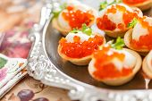 stock photo of canapes  - canape with caviar - JPG