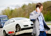 pic of tow-truck  - Man calling while tow truck picking up his broken car  - JPG