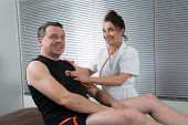 image of supervision  - Doctor supervising the recovery of a sportsman patient - JPG