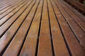 foto of lumber  - Reddish wooden deck background lumber pattern - JPG