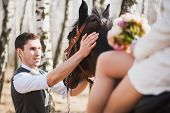 foto of brown horse  - Young people horseriding - JPG