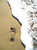 Footprint In Sand With Wave