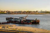 pic of barge  - River barge stands at mooring against Kazan on sunset - JPG