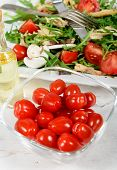pic of plum tomato  - Small tomatoes in a glass jar on white table