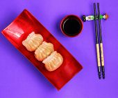 stock photo of siomai  - Vietnam style steamed shrimp dumplings served on a purple background - JPG