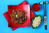 picture of stir fry  - Vietnamese beef stir fry served on a blue background - JPG