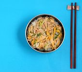 picture of rice noodles  - Vietnamese vermicelli chicken and rice noodles soup pho on a blue background - JPG