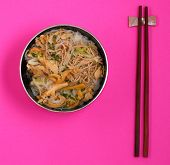 foto of rice noodles  - Vietnamese vermicelli chicken and rice noodles soup pho on a pink background - JPG