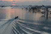 pic of fishnet  - Fisher view to commercial use big fishnet in lake - JPG