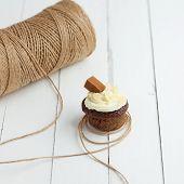 stock photo of chocolate muffin  - Homemade chocolate muffin on white wooden table - JPG