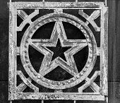 image of iron star  - Aged soviet Russian Star in cast iron with flakes and signs of age - JPG