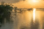 picture of fishnet  - Fisher view to commercial use big fishnet in lake - JPG