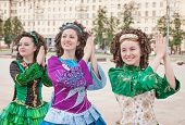 pic of wig  - Three women in irish dance dresses and wig posing outdoor - JPG